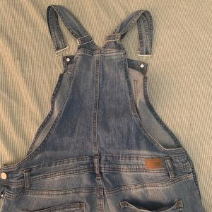 Overalls with ripped Knees